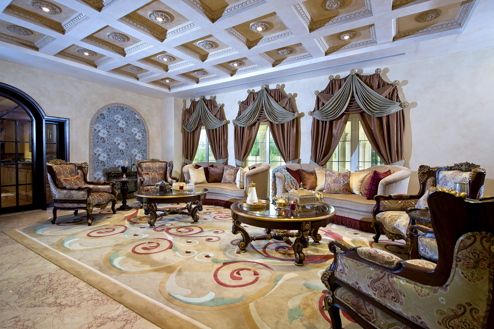 coffered ceiling with lighting in formal living room | blue and brown draperies with double swag
