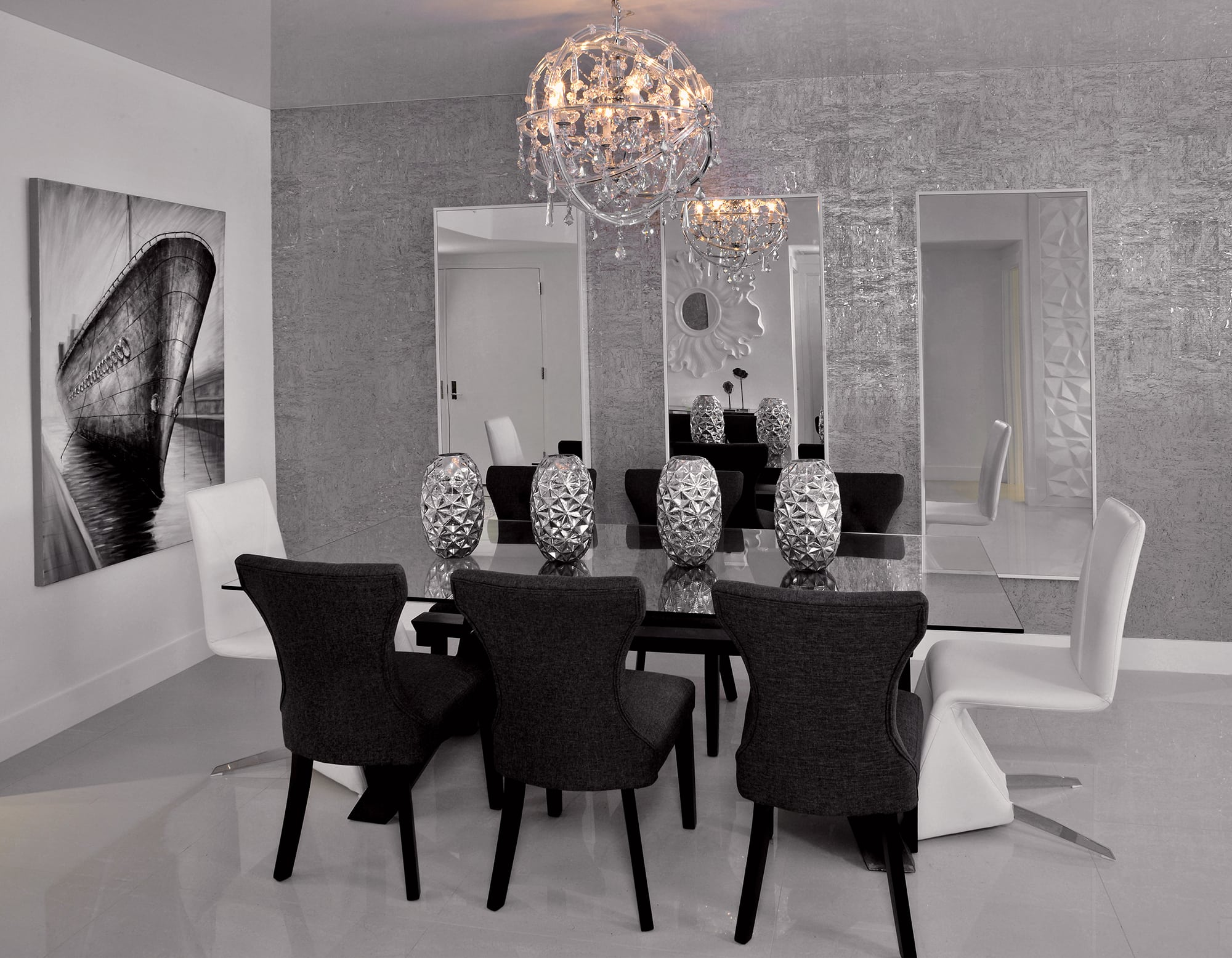 modern white, grey and black interior design of dining room with stretch ceiling and round chandelier